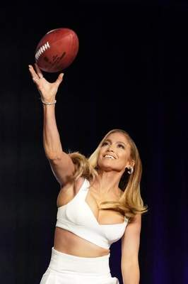 NFL Super Bowl 54 football game halftime performer Jennifer Lopez throws a football at a news conference Thursday, Jan. 30, 2020, in Miami. (AP Photo/Morry Gash)