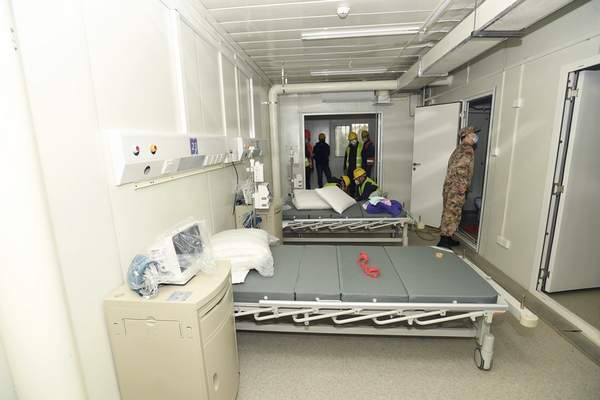 Chinatopix via AP  A Chinese army medic looks at a patient room at the Huoshenshan temporary field hospital in Wuhan in central China's Hubei Provinceon Sunday.