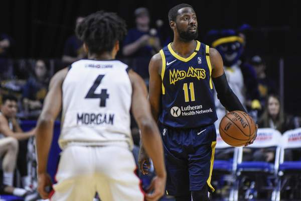 Mike Moore | The Journal Gazette Mad Ants guard Scoochie Smith looks to pass the ball in the first quarter against Toronto at Memorial Coliseum on Monday.