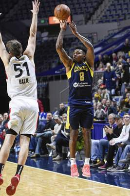 Mike Moore | The Journal Gazette Mad Ants guard Dexter Miles Jr. shoots a three-point basket over Raptors forward Nicholas Baer in the first quarter at Memorial Coliseum on Monday.