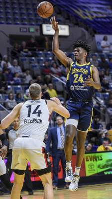 Mike Moore | The Journal Gazette Mad Ants forward Alize Johnson puts up a floater in the first quarter against Toronto Memorial Coliseum on Monday.