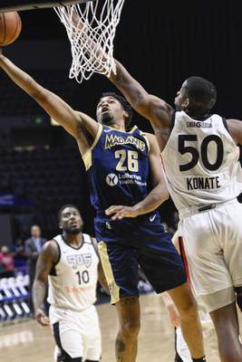 Mike Moore | The Journal Gazette  Mad Ants forward Ben Moore scores under the basket in the first quarter against Toronto at Memorial Coliseum on Monday.
