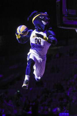 Mike Moore | The Journal Gazette The Mad Ant soares through the air before the start of the game between the Mad Ants and the Raptors at Memorial Coliseum on Monday.