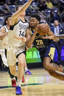 Mike Moore | The Journal Gazette  Mad Ants forward Ben Moore attacks the lane in the first quarter against Toronto at Memorial Coliseum on Monday.