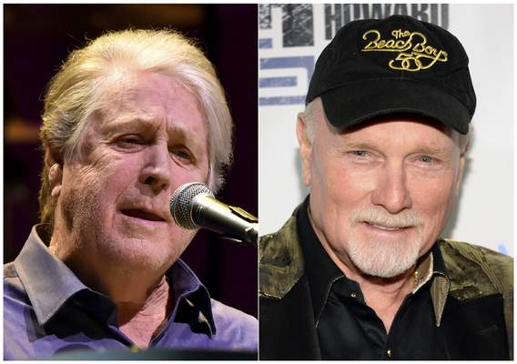 This combination photo shows Brian Wilson performing at the Rosemont Theatre in Rosemont, Ill, on Oct 6, 2017, left, and Mike Love at