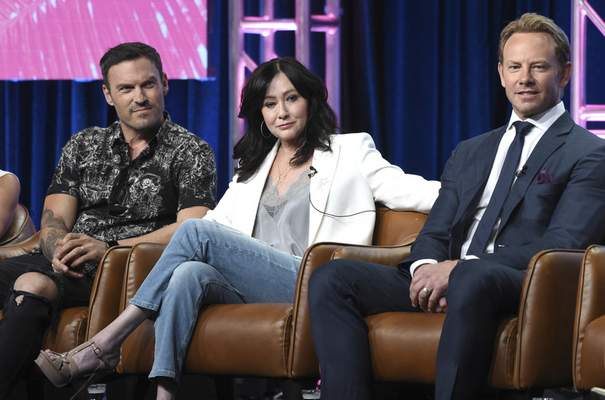 FILE - In this Aug. 7, 2019 file photo, Brian Austin Green, from left, Shannen Doherty and Ian Ziering participate in Fox's