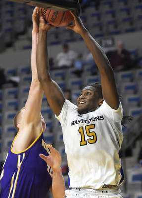 Katie Fyfe   The Journal Gazette  Purdue Fort Wayne guard Deonte Billups takes a shot during the first half against Western Illinois at Memorial Coliseum on Wednesday.