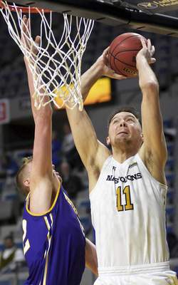 Katie Fyfe   The Journal Gazette  Purdue Fort Wayneforward Dylan Carl takes a shot during the first half against Western Illinois at Memorial Coliseum on Wednesday.