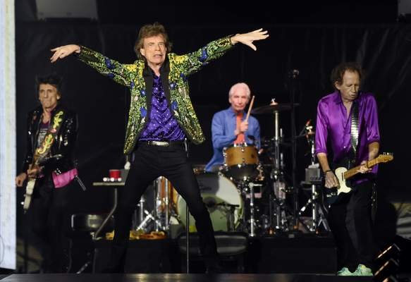 FILE - This Aug. 22, 2019 file photo shows, from left, Ron Wood, Mick Jagger, Charlie Watts and Keith Richards of the Rolling Stones performing in Pasadena, Calif. (Photo by Chris Pizzello/Invision/AP, File)