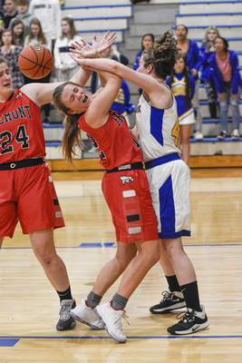 Mike Moore   The Journal Gazette  Blackhawk forward Sammie Miller, right fouls Fremont guard Macayla Guthrie in the second quarter of the IHSAA Girls Basketball Sectional at Blackhawk Christian High School on Friday.