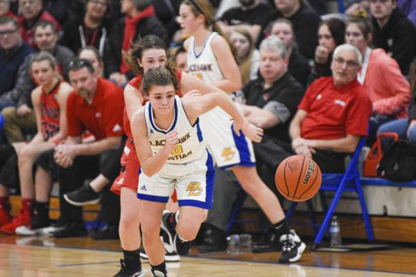 Mike Moore   The Journal Gazette  Blackhawk guard lily Helmuth chases down a loose ball in the third quarter against Fremont during the IHSAA Girls Basketball Sectional at Blackhawk Christian High School on Friday.
