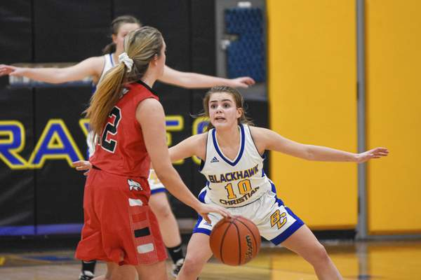 Mike Moore   The Journal Gazette  Blackhawk guard lily Helmuth, right guards Fremont guard Macayla Guthrie in the second quarter of the IHSAA Girls Basketball Sectional at Blackhawk Christian High School on Friday.