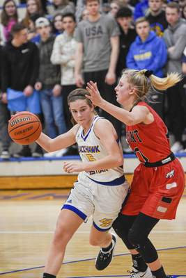Mike Moore   The Journal Gazette Fremont guard Jada Rhonehouse guards Blackhawk forward Hailee Kline as she drives to the basket in the second quarter of the IHSAA Girls Basketball Sectional at Blackhawk Christian High School on Friday.