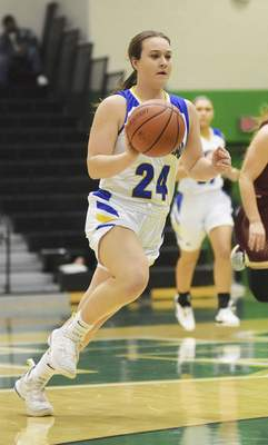 Katie Fyfe | The Journal Gazette Homestead senior Rylie Parker drives the ball down the court during the third quarter against Columbia City at South Side High School on Friday.