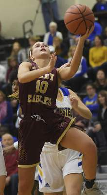 Katie Fyfe | The Journal Gazette Columbia City senior Grace Schrader shoots a layup during the second quarter against Homestead at South Side High School on Friday.