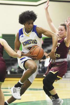 Katie Fyfe | The Journal Gazette Homestead sophomore Ayanna Patterson drives to the basket during the fourth quarter against Columbia City on Friday.