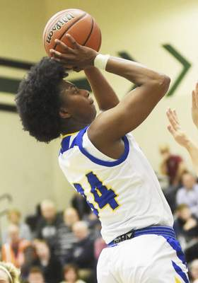Katie Fyfe | The Journal Gazette Homestead sophomore Ayanna Patterson takes a shot during the fourth quarter against Columbia City at South Side High School on Friday.