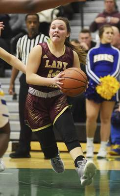 Katie Fyfe | The Journal Gazette Columbia City senior Carly Mabie drives to the basket during the second quarter against Homestead at South Side High School on Friday.