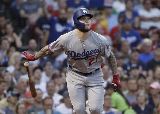 FILE - In this Friday, July 12, 2019 file photo, Los Angeles Dodgers' Alex Verdugo watches his solo home run during the second inning of the team's baseball game against the Boston Red Sox at Fenway Park in Boston. With less than a week before pitchers and catchers were scheduled to report to spring training, the Red Sox sent Mookie Betts and David Price to the Los Angeles Dodgers in a deal that brought outfielder Alex Verdugo and Twins pitching prospect Brusdar Graterol to Boston. (AP Photo/Elise Amendola, File)