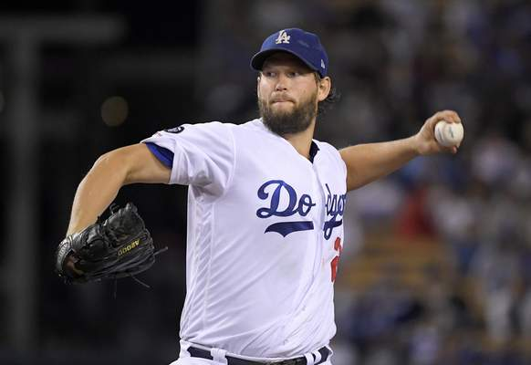 FILE - This Sept. 20, 2019 file photo shows Los Angeles Dodgers starting pitcher Clayton Kershaw pitching to the Colorado Rockies baseball team in Los Angeles. In what's become a familiar refrain, the Dodgers arrive at camp still looking for their first World Series championship since 1988. After losing in two straight World Series, they were ousted by Washington in five games in the NL Division Series last fall. The team had a quiet offseason,(AP Photo/Mark J. Terrill, File)