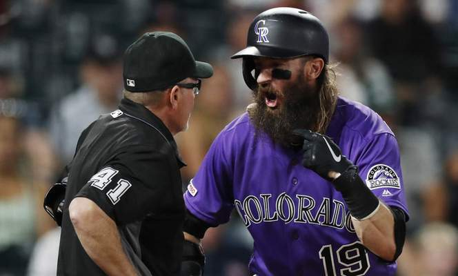 FILE - In this Aug. 28, 2019, file photo, home plate umpire Jerry Meals, left, listens as Colorado Rockies' Charlie Blackmon argues over a called-third strike in the ninth inning of a baseball game against the Boston Red Sox in Denver. Meals ejected Blackmon from the game. Blackmon is one of the key players on the roster as the Rockies head to Arizona to open spring training. (AP Photo/David Zalubowski, File)