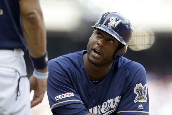 FILE - In this Sunday, July 28, 2019 file photo, Milwaukee Brewers' Lorenzo Cain talks during the eighth inning of a baseball game against the Chicago Cubs in Milwaukee. The Milwaukee Brewers have a lot of work to do in spring training. Lorenzo Cain also is feeling better after the Gold Glove center fielder was bothered by leg injuries at the end of last season. (AP Photo/Aaron Gash, File)