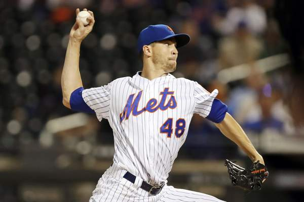 FILE - In this Sept. 25, 2019, file photo, New York Mets starting pitcher Jacob deGrom throws during the first inning of a baseball game against the Miami Marlins in New York. The right hander is coming off his second consecutive Cy Young Award(AP Photo/Kathy Willens, File)
