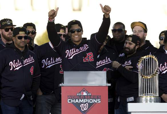 FILE - In this Nov. 2, 2019, file photo, Washington Nationals left fielder Juan Soto, center, celebrates with teammates during a rally following a parade to celebrate the team's World Series baseball championship over Houston Astros in Washington. The Nationals head to spring training with mostly the same squad that won the World Series. They are counting again on being led by a star-studded rotation featuring Max Scherzer and Stephen Strasburg, along with slugger Soto. (AP Photo/Jose Luis Magana, File)