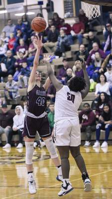 Mike Moore | The Journal Gazette Garrett sophomore Morgan Ostrowski shoots over Concordia junior Chastity Craig in the second quarter of the IHSAA Girls Basketball Sectional Championship at Concordia Lutheran High School on Saturday.