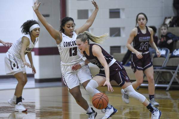 Mike Moore | The Journal Gazette Concordia sophomore LonDynn Betts guards Garrett sophomore Nataley Armstrong in the first quarter of the IHSAA Girls Basketball Sectional Championship at Concordia Lutheran High School on Saturday.