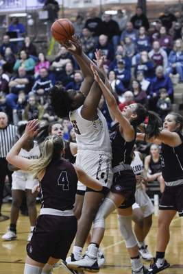 Mike Moore | The Journal Gazette Concordia junior Chanteese Craig takes a shot at the basket in the first quarter against Garrett during the IHSAA Girls Basketball Sectional Championship at Concordia Lutheran High School on Saturday.