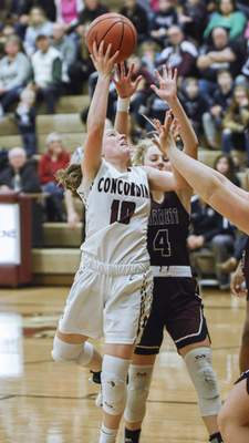 Mike Moore | The Journal Gazette  Concordia junior Rhaya Kaschinske goes up under the basket in the first quarter against Garrett during the IHSAA Girls Basketball Sectional Championship at Concordia Lutheran High School on Saturday.