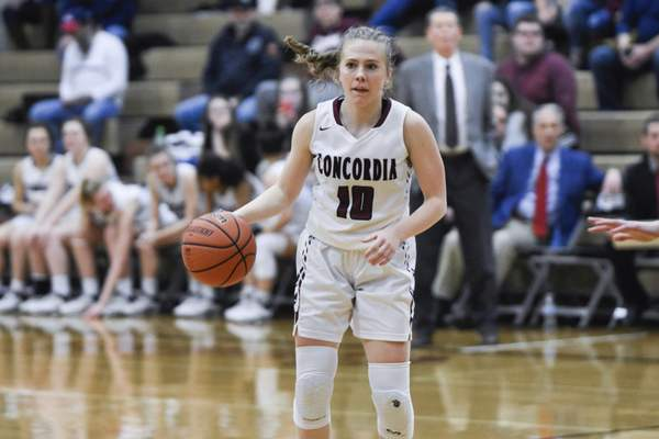 Mike Moore | The Journal Gazette Concordia junior Rhaya Kaschinske looks to pass the ball in the first quarter against Garrett during the IHSAA Girls Basketball Sectional Championship at Concordia Lutheran High School on Saturday.