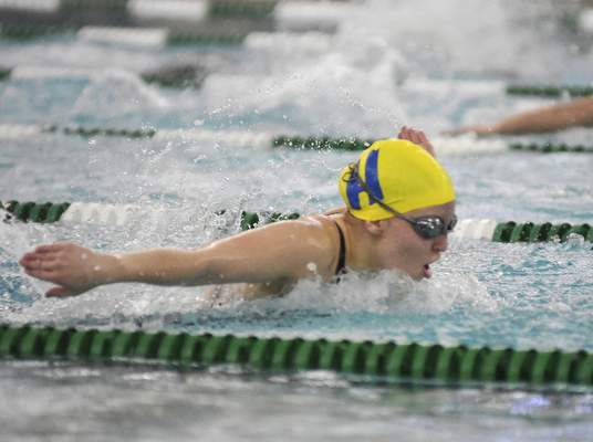 Katie Fyfe   The Journal Gazette  Homestead junior Audrey Crowel competes in the girls 100-yard butterfly during the Sectional Swimming & Diving Finals at the Helen P. Brown Natatorium on Saturday.