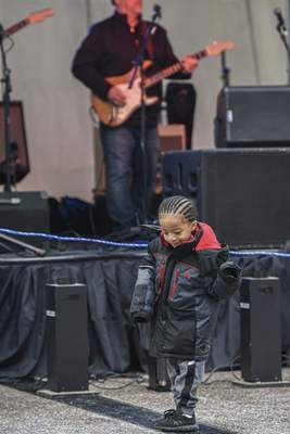 Mike Moore | The Journal Gazette Brycen Rockwell-Ashton, 4 rocks out to live music on The Landing downtown on Saturday during the 5th annual Weather the Fort celebration.