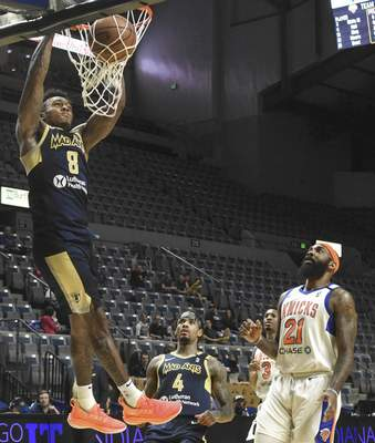 Michelle Davies   The Journal Gazette  The Mad Ants' Daxter Miles Jr., goes up for a dunk while teammate Walt Lemon Jr., and Westchester's JJ Moore look on in the first half of Thursday's game at the Memorial Coliseum.