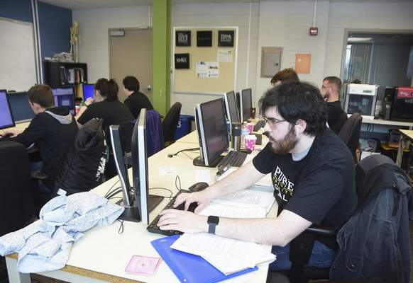 Katie Fyfe | The Journal Gazette  Purdue University's Tyler Jones  competes in Saturday's Indiana Collegiate Cyber Defense Competition at Indiana Tech.