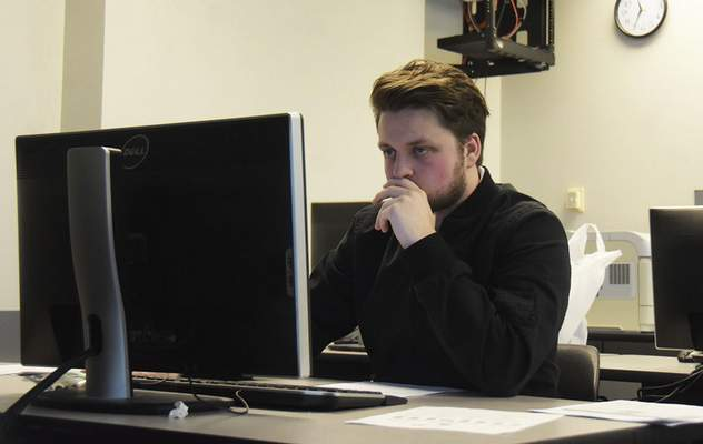 Katie Fyfe | The Journal Gazette Carson Sanderson with Indiana Tech's Cyber Warriors focuses on Saturday's state competition, which the team has won six straight years.