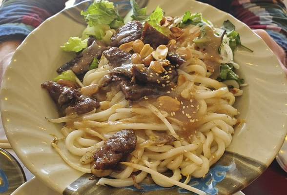 Pan-fried udon noodles with beef from West Coast Grill on South Calhoun Street.