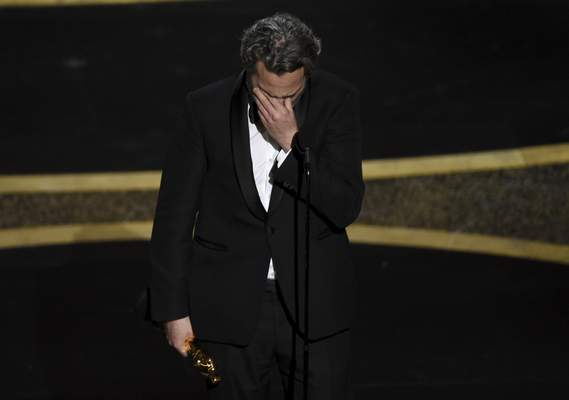 Joaquin Phoenix reacts as he accepts the award for best performance by an actor in a leading role for