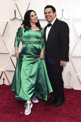 Kristen Anderson-Lopez, left, and Robert Lopez arrive at the Oscars on Sunday, Feb. 9, 2020, at the Dolby Theatre in Los Angeles. (Photo by Jordan Strauss/Invision/AP)