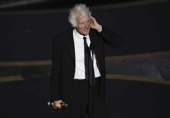 Roger Deakins accepts the award for best cinematography for