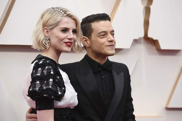 Lucy Boynton, left, and Rami Malek arrive at the Oscars on Sunday, Feb. 9, 2020, at the Dolby Theatre in Los Angeles. (Photo by Jordan Strauss/Invision/AP)