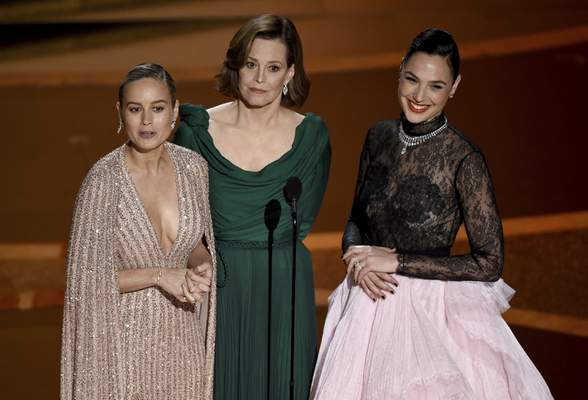 Brie Larson, from left, Sigourney Weaver and Gal Gadot introduce a performance by maestro Eimear Noone at the Oscars on Sunday, Feb. 9, 2020, at the Dolby Theatre in Los Angeles. (AP Photo/Chris Pizzello)