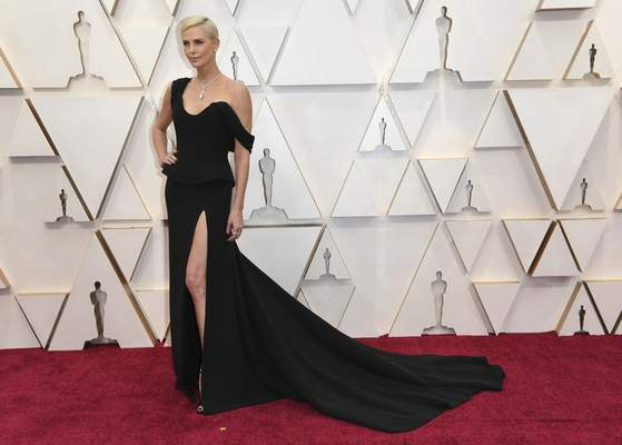 Charlize Theron arrives at the Oscars on Sunday, Feb. 9, 2020, at the Dolby Theatre in Los Angeles. (Photo by Richard Shotwell/Invision/AP)