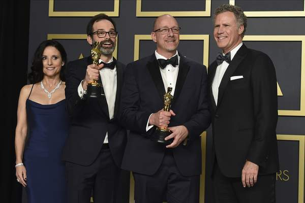 Julia Louis-Dreyfus, from left, Andrew Buckland, Michael McCusker, winners of the award for best film editing for