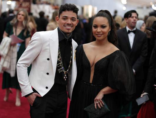 Anthony Ramos, left, and Jasmine Cephas Jones arrive at the Oscars on Sunday, Feb. 9, 2020, at the Dolby Theatre in Los Angeles. (AP Photo/John Locher)