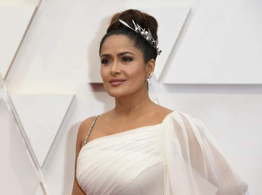 Salma Hayek arrives at the Oscars on Sunday, Feb. 9, 2020, at the Dolby Theatre in Los Angeles. (Photo by Richard Shotwell/Invision/AP)