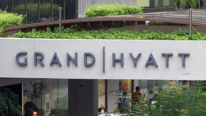 This image made from video shows the exterior of the Grand Hyatt hotel in Singapore, Monday, Feb. 10, 2020. (AP Photo)