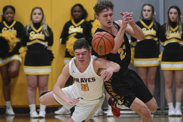 Blackhawk junior Andrew McIntosh, left, and Snider senior Dillon Duff collide while chasing down a loose ball.